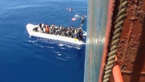 Dramatic video of migrants being rescued from rubber dinghy