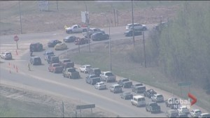 Aerial video show traffic jam leading out of Fort McMurray