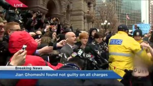 Topless Protester interrupts crown attorney following Ghomeshi verdict