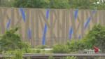 Bleu de bleu: Artist commissioned to paint Montreal sound wall