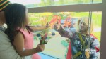 Super surprise: costumed characters brighten the day at Children's Hospital