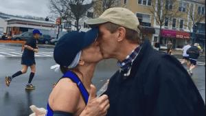 Boston Marathon runner kisses mystery man