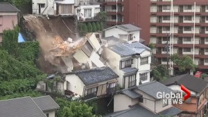 Mudslide in Japan sends house toppling down hill