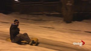 Tobogganing on icy East Vancouver street