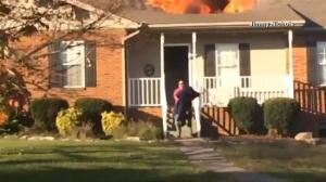 Good Samaritan runs into burning home to save family dog