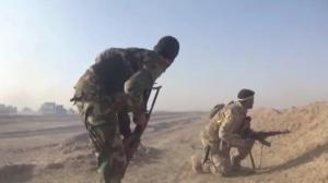 Raw video: Iraqi government forces battle IS milita