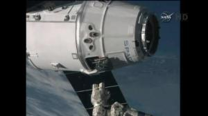 SpaceX resupply craft docks with ISS