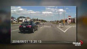 Calgary dashcam video catches close call involving 3 kids on scooters