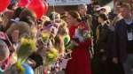 Crowd gathers for Prince William and Kate's at Yong Art Festival on Main Street