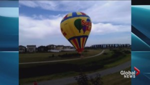 Hot air balloon lands on walking path in Harbour Landing