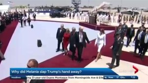 Why did Melania slap Trump's hand away?