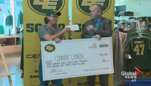 Eskimos' 50/50 cheque presented