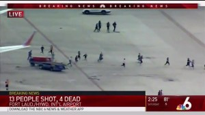 People run across tarmac at Fort Lauderdale Airport