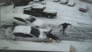Security footage shows scary moment car slides out of control, hitting another car that hits woman
