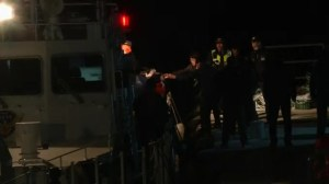 Boat brings to port bodies from the capsized ferry in South Korea