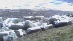 Huge ice chunks pile up on shore of Kuskokwim River in Alaska