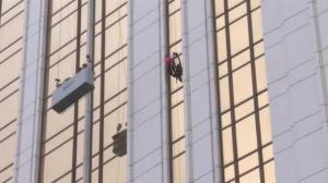 'French Spider-Man' scales 500 foot building in Macau, China