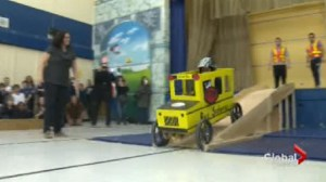 Students at St. Raymond Catholic School build and race cars made of cardboard
