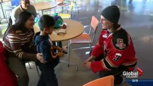 Calgary Hitmen deliver Teddy Bear Toss stuffies