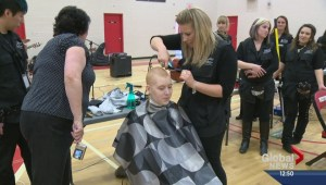High school students shave heads for cancer