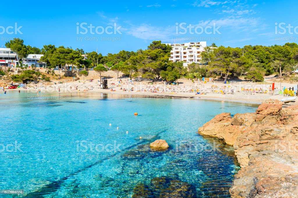 View Of Beach With Azure Sea Water In Cala Portinatx Bay Ibiza     View of beach with azure sea water in Cala Portinatx bay  Ibiza island   Spain