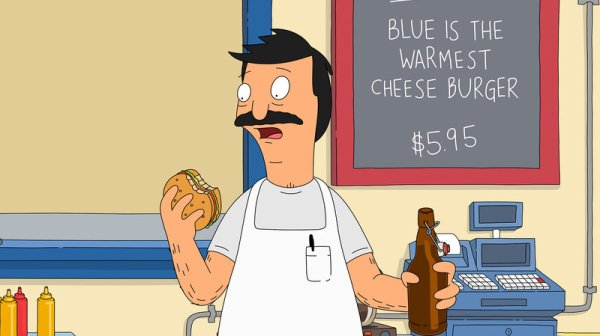 Bob Belcher, titular hero of Bob's Burgers, bites into one of his creations. Each episode features daily burger specials with chuckle-inducing names. The burgers were born in the show writers' imagination and brought to life in Cole Bowden's kitchen.