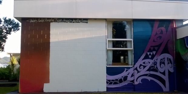 The mural at Tikipunga High School was painted over with white paint.