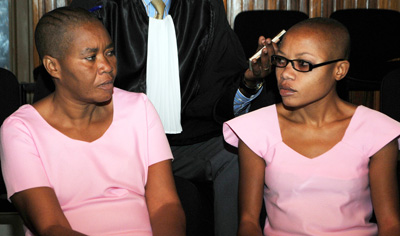 Saidati Mukakibib, left, and Agnes Uwimana Nkusi sit in Rwandan Supreme Court in January 2012. (AFP/Steve Terrill)