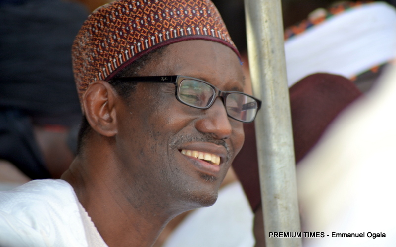 FILE PHOTO: Nuhu Ribadu smiles to himself as fans cheer during a rally