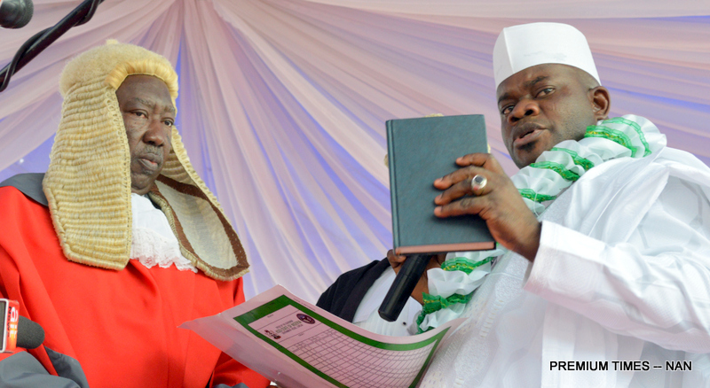 PIC. 7. ALHAJI YAHAYA BELLO (R), TAKING OATH OF OFFICE AS GOVERNOR OF KOGI AT HIS INAUGURATION, BEFORE THE CHIEF JUDGE OF THE STATE, JUSTICE NASIRU AJANA, IN LOKOJA ON WEDNESDAY (27/1/16). 0504/27/1/2016/BJO/NAN