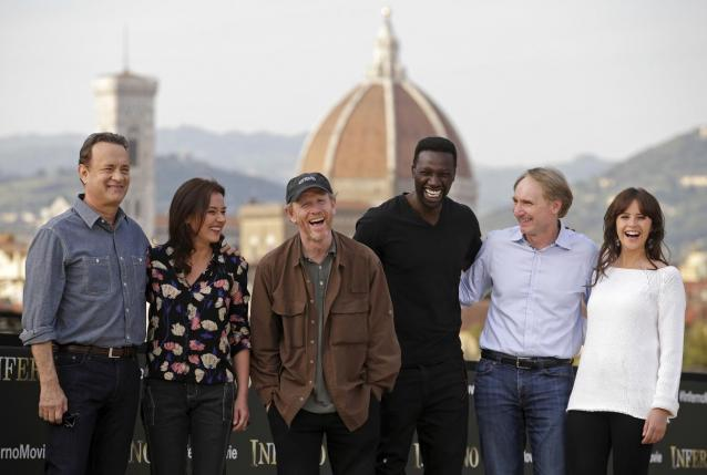 """Tom Hanks, Sidse Babett Knudsen, Ron Howard, Omar Sy, Dan Brown and Felicity Jones pose during a photocall for the movie """"Inferno"""" in downtown Florence"""