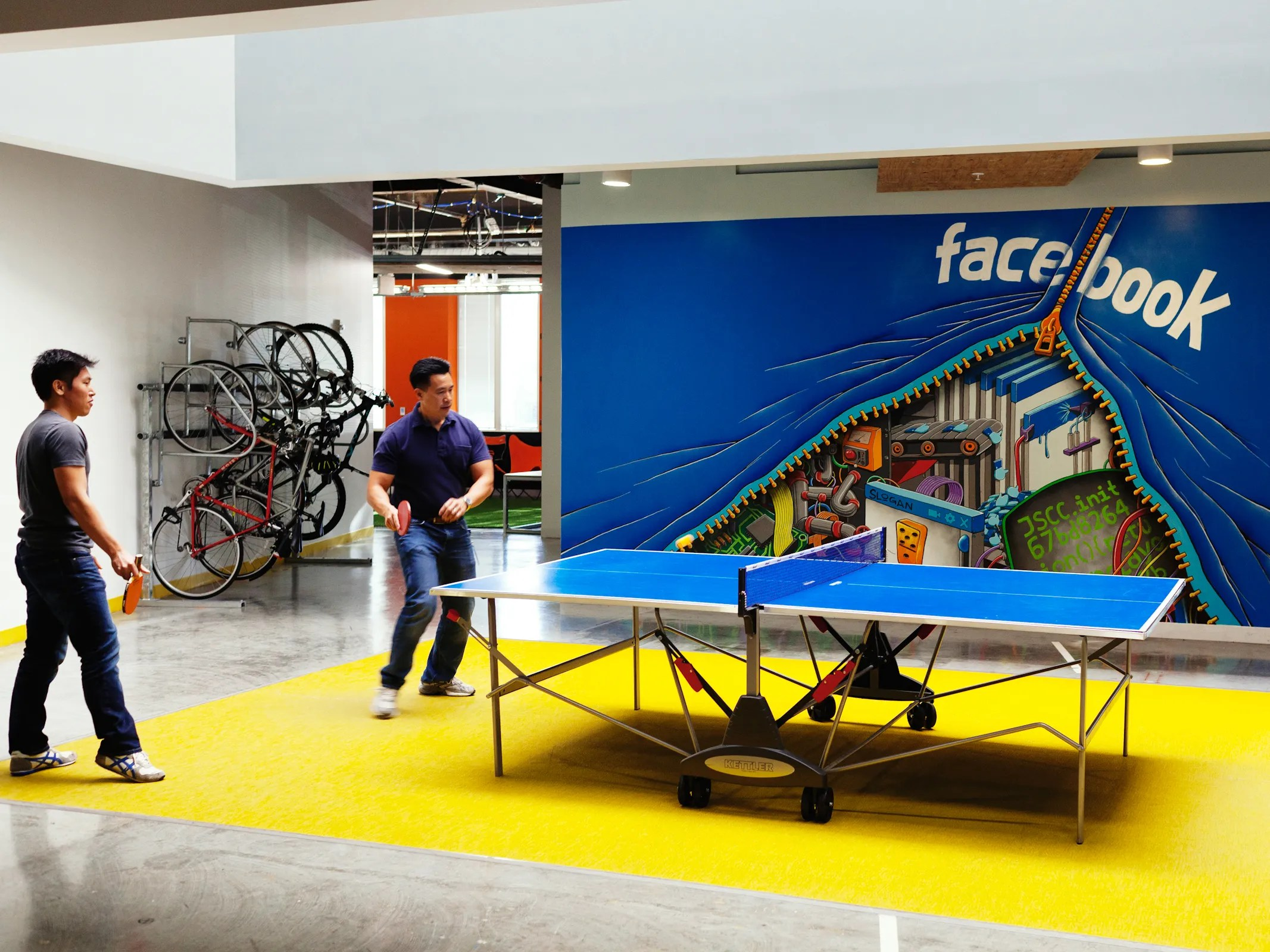 127inside facebook headquarters in menlo park california employees play ping pong front of a mural by artist shaun loganpeter mccolloughwired office