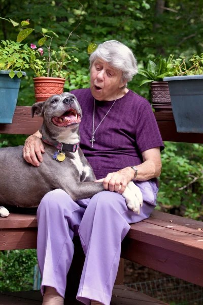 Sister Virginia Johnson gives Remy a hug at their home in Nyack, New York.
