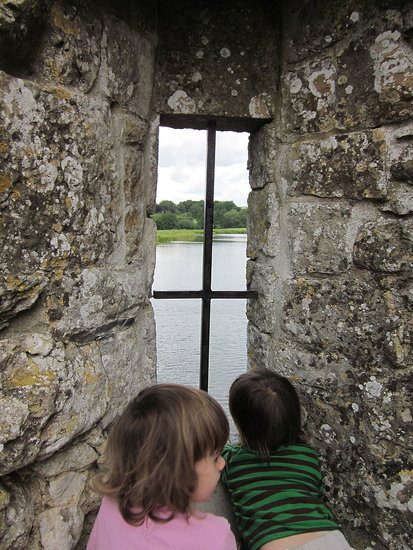 Twins exploring the old castle ruins at Leeds Castle