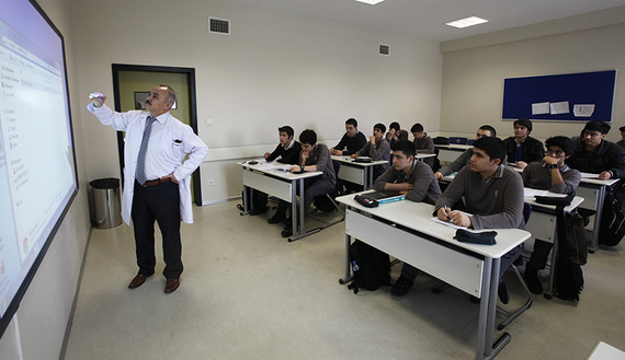 Students attend a geometry class at Fatih College in Istanbul