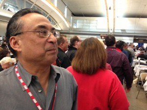 Michael Cabanatuan, Chronicle member and regional VP of the Guild, waited in line Monday to cast a roll-call vote at CWA convention in Pittsburgh.