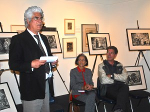 David de la Torre, director of the Mexican Museum in Fort Mason Center, discusses the prints of Leopoldo Mendez that are displayed on the easels behind him.  Karen Zukor, who restored the prints, and Guild executive officer Carl Hall, look on.  The three panelists spoke about Mendez's art at a LaborFest event on Tuesday evening. Photo by Kat Anderson 2014.