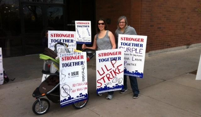 ASLIU members in Denver make the ULP strike a family affair. Photo courtesy CWA staff 2014.