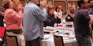 TNG delegates give standing ovation to CWA President Larry Cohen.  Janelle Hartman/newsguild.org 2015.