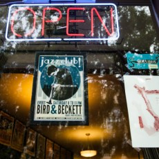 Posters promoting live jazz and an in-house gallery festoon the front window of Bird & Beckett Books and Records in Glen Park. (Photo by Ekevara Kitpowsong/Bay News Rising 2015)