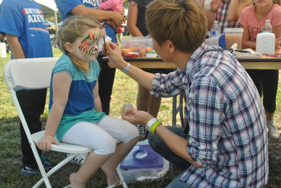 Harper, 4, gets face paint. She is the daughter of Southwest flight attendants
