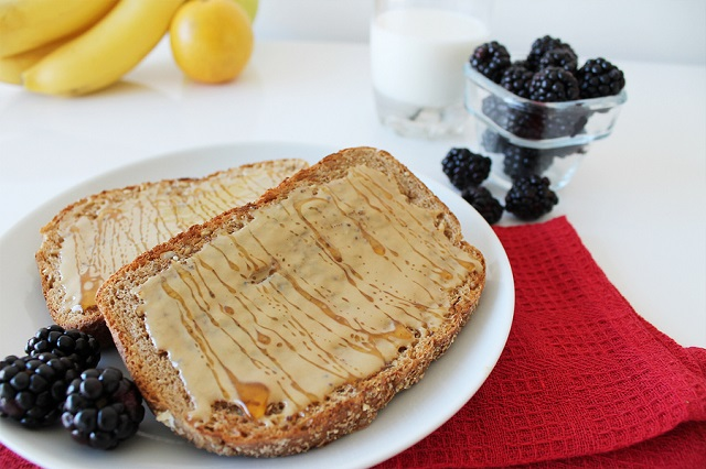 Toasted bread with sesame tahini and honey on a tablecloth. Breakfast concept