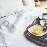 bigstock-breakfast-on-a-tray-in-bed-in-124415717
