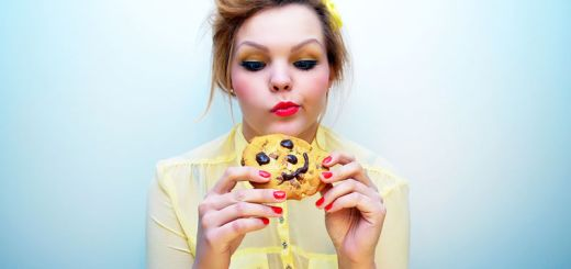 bigstock-trendy-young-woman-is-eating-a-91885535