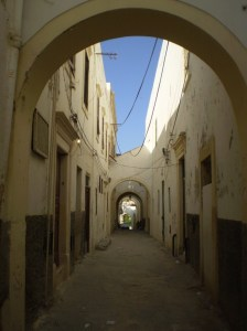 A narrow street running through a residential area in Tripoli, Libya. Image