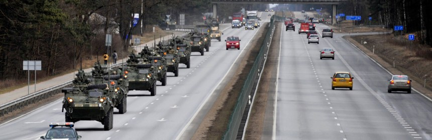 FILE - A Sunday, March 22, 2015 file photo showing Stryker vehicles of the US Army?s 2nd Cavalry Regiment rolling down the highway, during ''Dragoon Ride'' military exercise,  in Riga, Latvia. The troops began the trek on March 21, and will travel through Latvia, The Czech Republic and onto Germany by April 1 in an exercise designed to reinforce America's allies. (AP Photo/Oksana Dzadan, File)