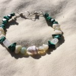 "Small ~6.5"" bracelet on nylon-coated wire string, wire clasps and various gemstone beads including green malachite, shells, moonstone, and coral.  $7.50 - Send me a message via the contact page to get my PayPal info for purchase, with the item name."