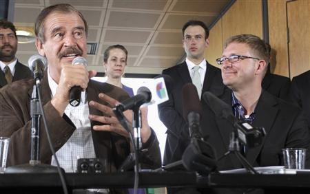 Former President of Mexico Fox talks during a news conference next to marijuana entrepreneur and CEO of Diego Pellicer Inc. Shively in Seattle, Washington