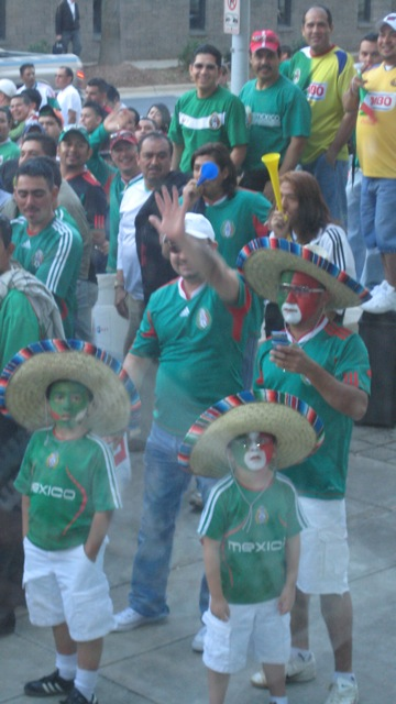 Fans of the Mexican soccer team await their heroes outside the hotel in Charlotte, North Carolina