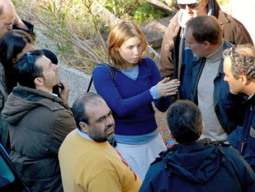 Amanda Knox meets with Italian police outside of her housing, the day after the murder of Ms. Meredith Kercher